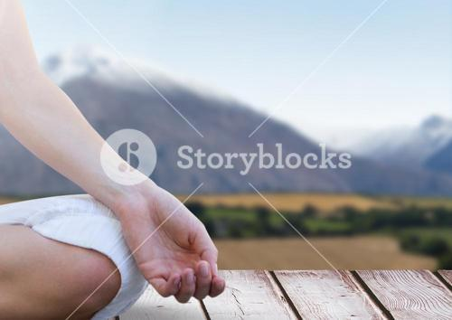 Womans hand Meditating by mountains