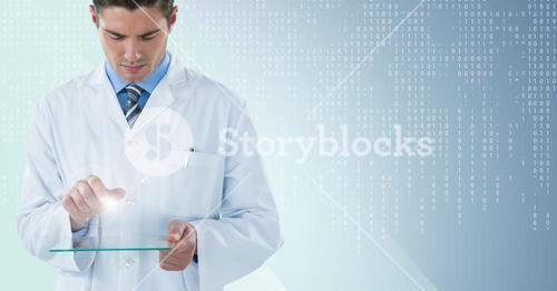 Man in lab coat looking down at glass device with flare against blue background with white binary co