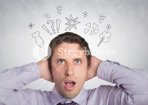 Man in lavendar shirt with hands on head with doodles against white wall