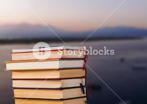 Books stacked by harbour