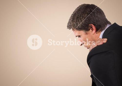Business man with hand on shoulder against cream background