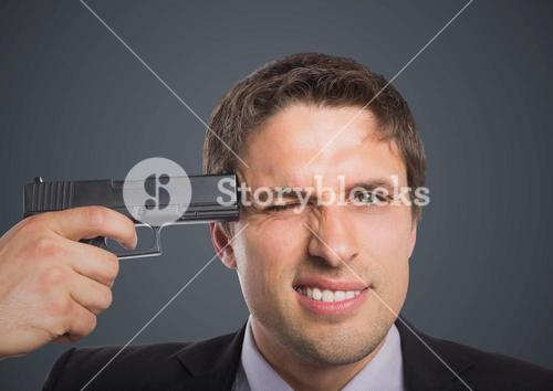 Close up of business man with gun to head against grey background