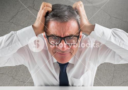 Stressed man against cracking concrete background
