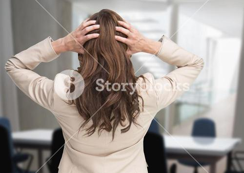 Stressed woman in office meeting room