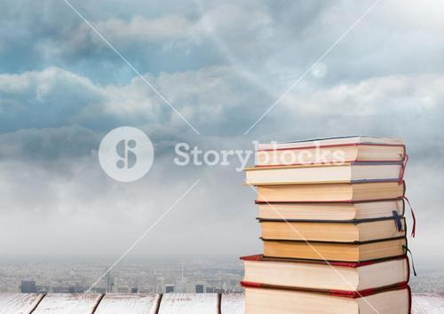 Books stacked by clouds