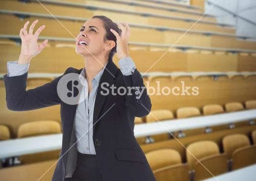 Stressed woman in lecture theatre classroom