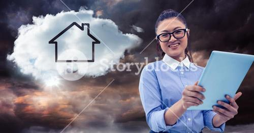 Woman with tablet and cloud with house against stormy sky