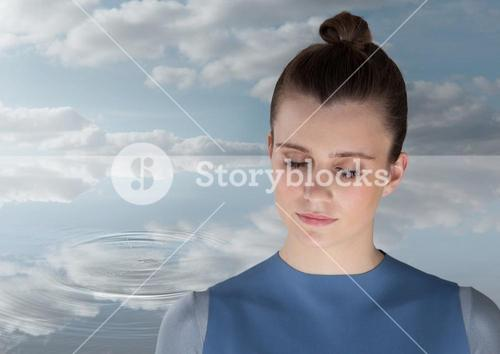 Woman Meditating peacefully by water ripple of clouds
