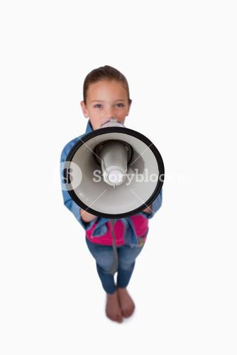 Portrait of a girl speaking through a megaphone