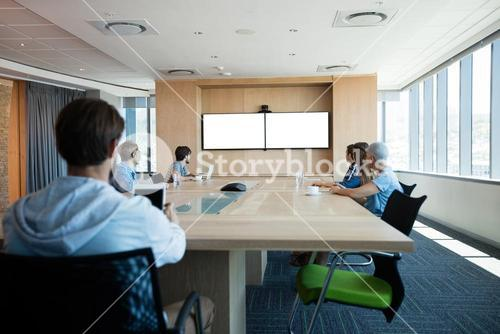 Creative business team attending a video call in conference room