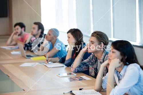 Bored creative business team attending a meeting