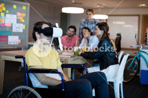 Physically disabled man on wheelchair using VR headset