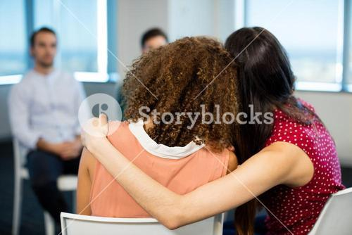 Creative businesswoman embracing each other at office