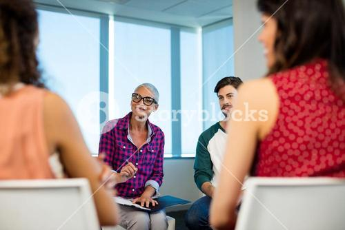Creative business team discussing at office