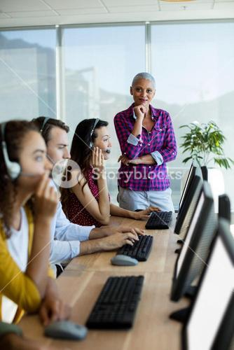 Customer service executive trainer monitoring her team