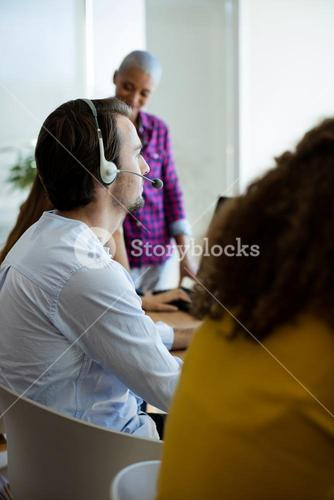 Customer service executive working in office