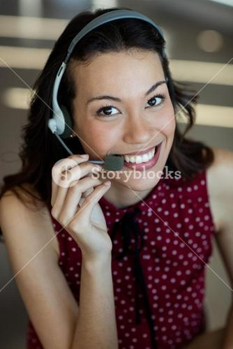 Customer service talking on headset in office