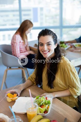 Portrait of smiling woman having meal