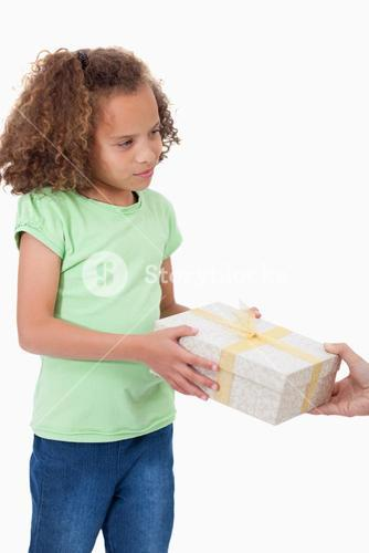 Portrait of a young girl receiving a gift