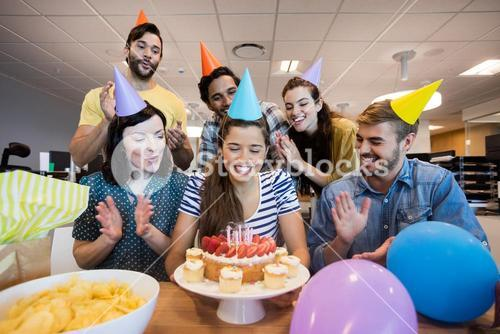 Creative business team celebrating colleagues birthday