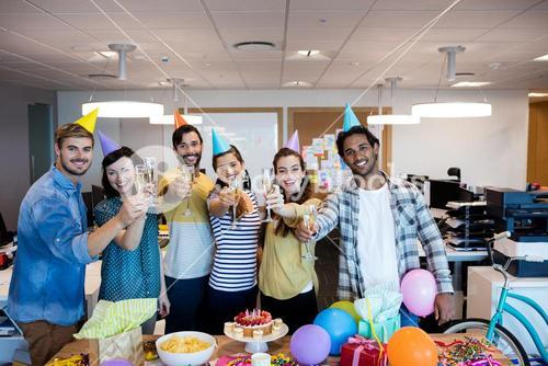 Creative business team having a toast on colleges birthday