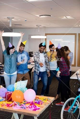 Creative business team dancing together