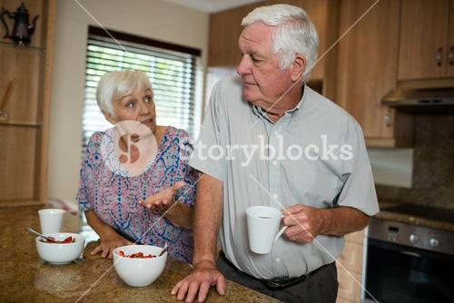 Senior couple arguing in kitchen