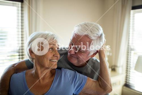Senior couple romancing in bedroom