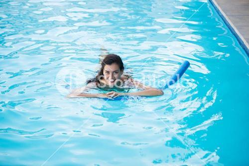 Young woman swimming with inflatable tube