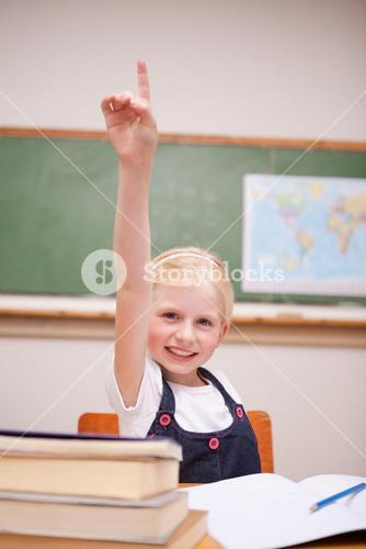 Portrait of a girl raising her hand