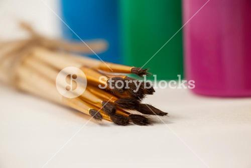 Paint brushes and watercolor paints