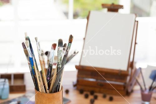 Set of paint brushes in a jar
