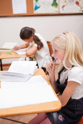 Portrait of pupils doing classwork