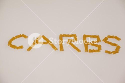 Conchiglie pasta arrange in shape of carbs text