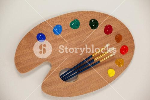 Palette with multiple colors and paint brushes