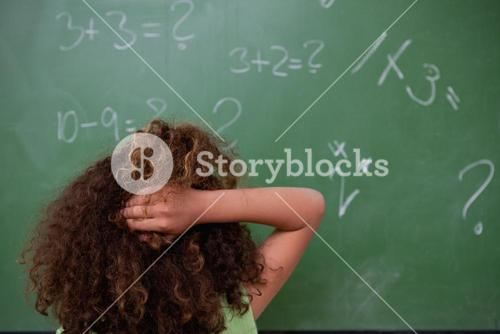 Schoolgirl thinking about mathematics while scratching the back of her head