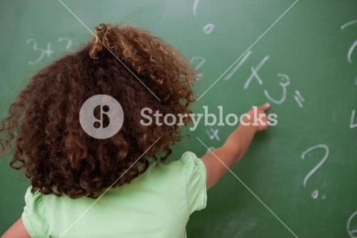 Schoolgirl pointing at an addition