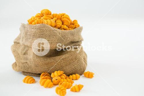 Sack full of yellow pasta