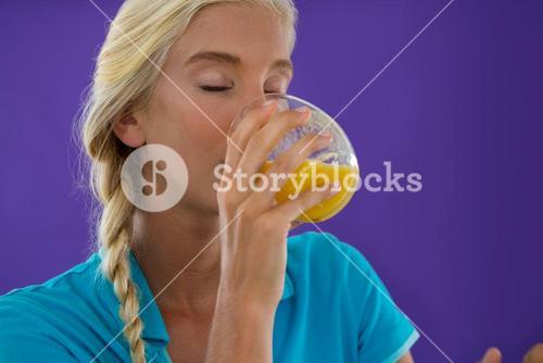Beautiful woman drinking smoothie