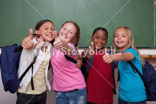 Classmates posing with the thumb up