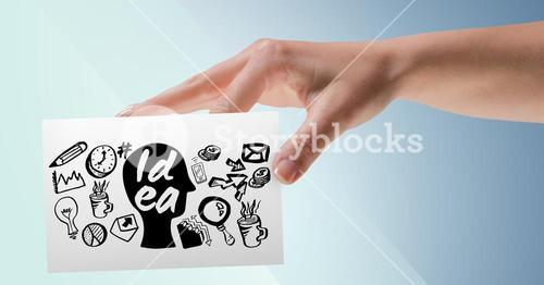 Hand with card and black idea doodles against blue background