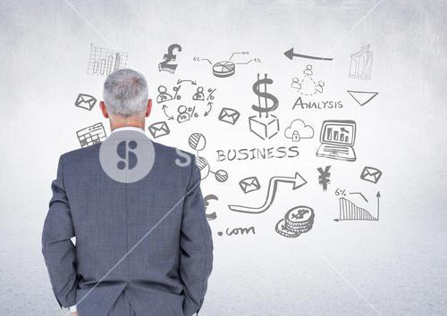Businessman with business graphics drawings