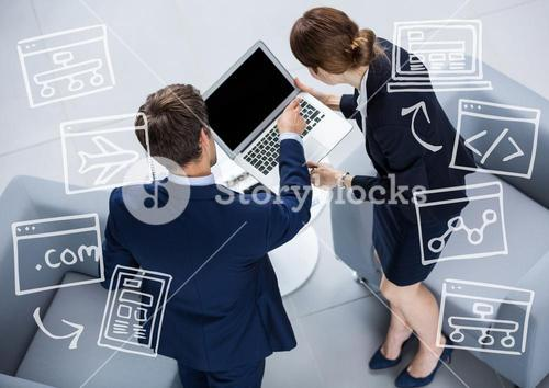 Overhead of business man and woman with white business doodles