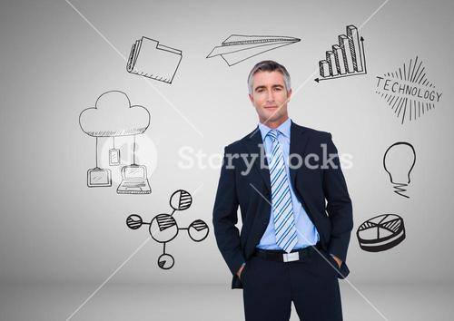 Businessman with technology and business graphics drawings