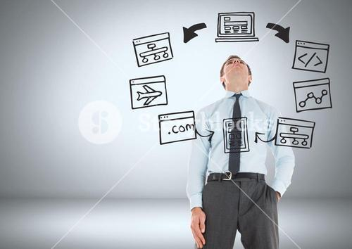 Businessman with computer screens graphics drawings