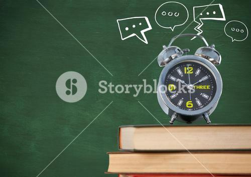 Pile of books with clock and white speech bubbles against green chalkboard