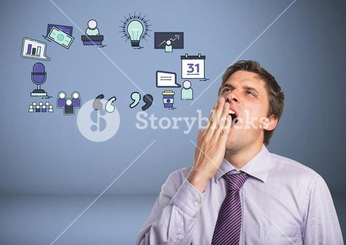 Businessman yawning tired with business graphics drawings