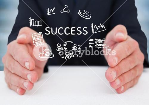 Business man hands on table with white doodles