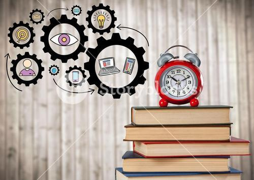 Pile of books and clock with gear graphics against blurry wood panel