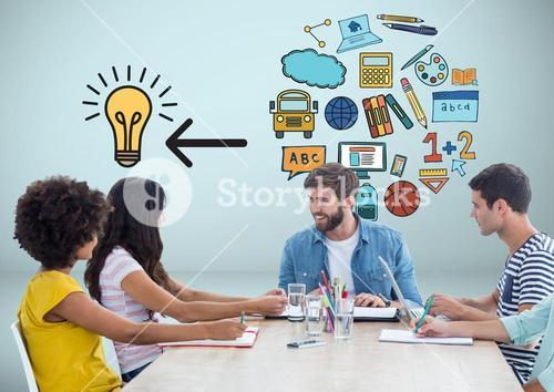 People at desk together with education ideas graphics drawings